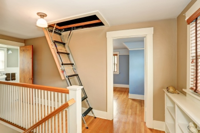 Hallway interior with folding attic ladder
